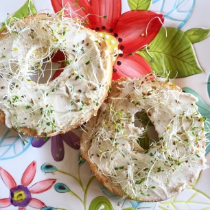 Herbed bagel with 'cream cheese' and sprouts